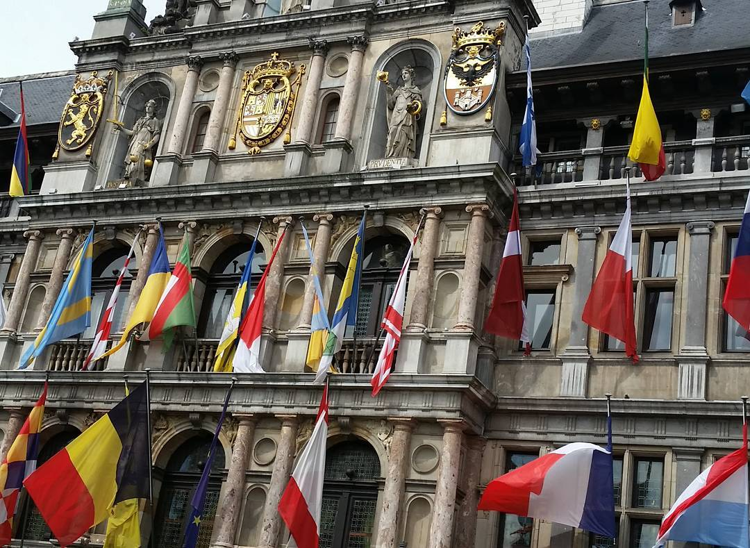 An old building with lots of flags