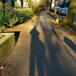 My shadow stretching in front of me on a quiet West End sidewalk