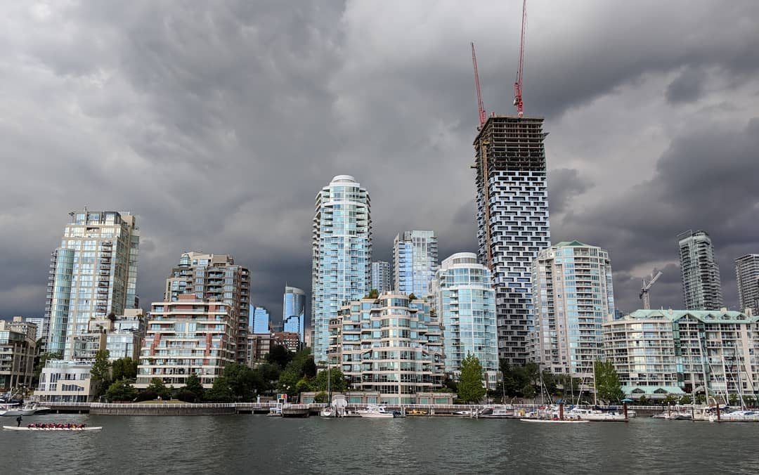 Towers under heavy grey clouds