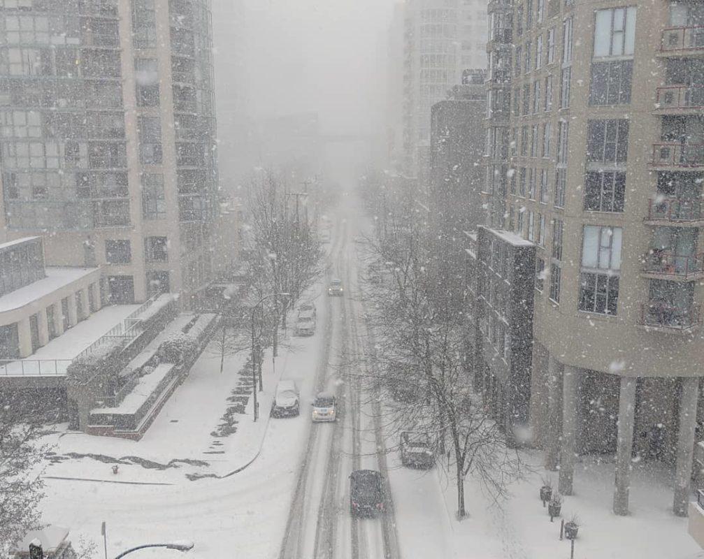 Beach Avenue, snow falling down
