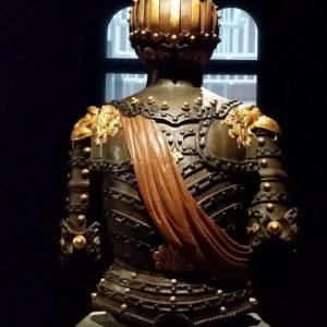 wooden figure with orange sash