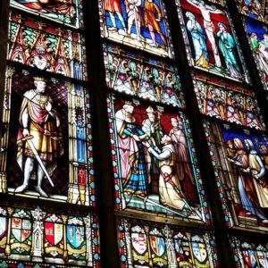 Stained glass representing medieval scenes
