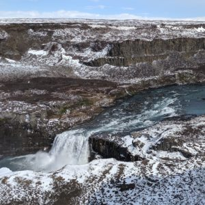 a little waterfall in brown and snowy landscape