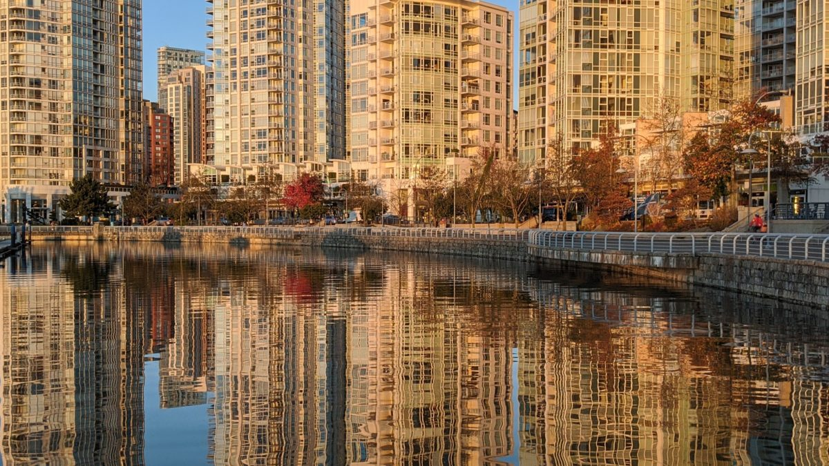 Reflected towers on seawall